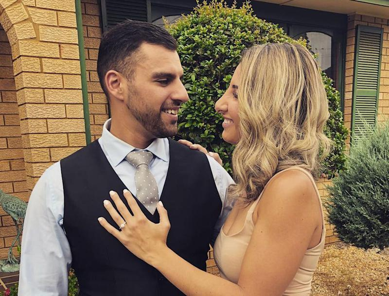 Chris Davidson with his fiancee Bianca Alchi. The couple's engagement party nearly turned into a disaster after Ms Alchi's father filled up a ute with the wrong fuel. But a kind mechanic leant the family his. Source: Supplied/ Bianca Alchi