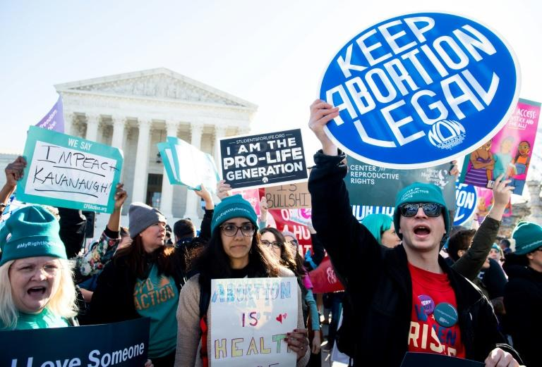 Activists outside the US Supreme Court as it hears what may be the most significant case on abortion in decades