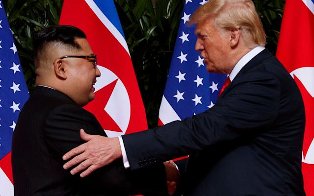 President Donald Trump meets with North Korean leader Kim Jong Un on Sentosa Island, Tuesday, June 12 - AP