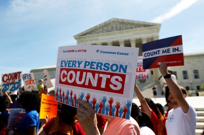FILE PHOTO: Demonstrators gather outside the U.S. Supreme Courthouse in Washington
