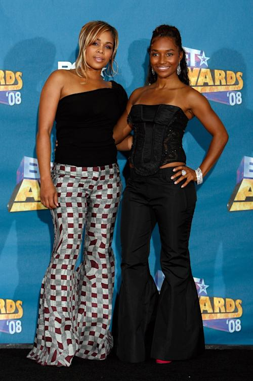 "FILE- In this June 24, 2008 file photo, Tionne ""T-Boz"" Watkins, left, and Rozonda ""Chilli"" Thomas pose backstage at the BET Awards in Los Angeles. For R&B singer Tionne ""T-Boz"" Watkins of the Grammy-winning TLC, it has been a rocky road since the 2002 death of Lisa ""Left Eye"" Lopez. Now, she puts her life on display through her new reality show, ""Totally T-Boz,"" an hour-long, four-episode series that airs on cable network TLC on Tuesdays, which premiered on Jan. 1, 2013. (AP Photo/Danny Moloshok, File)"