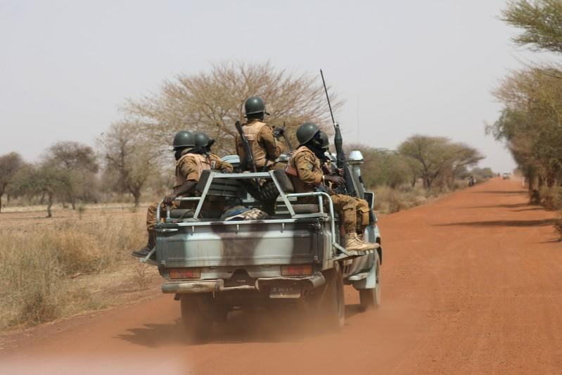 FILE PHOTO: Soldiers from Burkina Faso patrol on the road of Gorgadji in the Sahel area of Burkina Faso