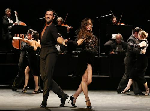 "In this July 11, 2013 photo released by The O + M Company, Maksim Chmerkovskiy, left, and Karina Smirnoff perform in ""Forever Tango"" at the Walter Kerr Theatre in New York. (AP Photo/The O + M Company, Walter McBride)"