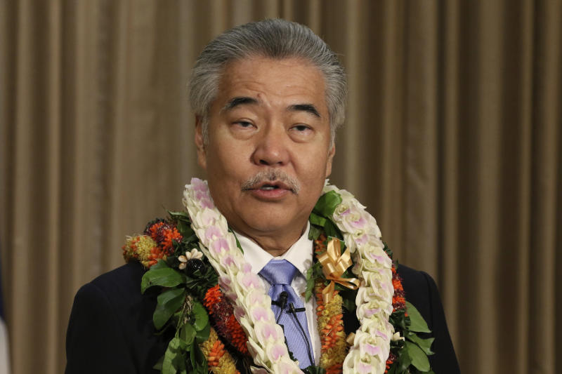 FILE - In this Jan. 21, 2020, file photo, Gov. David Ige speaks to reporters in Honolulu after delivering his state of the state address at the Hawaii State Capitol.  Many state and local governments across the country have suspended public records requirements amid the coronavirus pandemic, denying or delaying access to information that could shed light on key government decisions. Ige issued one of the most sweeping orders, suspending the state's entire open-records law in mid-March.  (AP Photo/Audrey McAvoy, File)