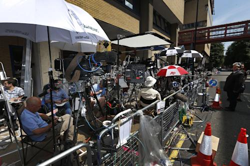Members of the media wait across St. Mary's Hospital exclusive Lindo Wing in London, Sunday, July 14, 2013. Media are preparing for royal-mania as Britain's Duchess of Cambridge plans to give birth to the new third-in-line to the throne in mid-July, at the Lindo Wing. Cameras from all over the world are set to be jostling outside for an exclusive first glimpse of Britain's Prince William and the Duchess of Cambridge's first child. (AP Photo/Lefteris Pitarakis)