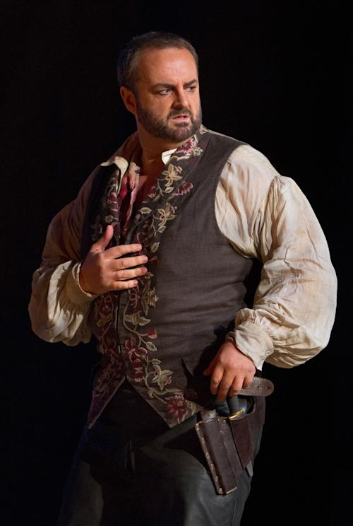 """In this Sept. 27, 2012 photo provided by the Metropolitan Opera, Gwyn Hughes-Jones plays the role of Manrico during a dress rehearsal of Verdi's """"Il Trovatore,"""" at the Metropolitan Opera in New York. (AP Photo/Metropolitan Opera, Marty Sohl)"""
