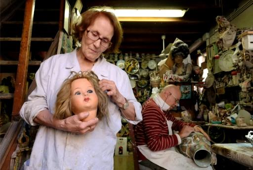 The workshop overflows with objects long forgotten by customers. Puppets, toy soldiers and 100-year-old earthenware pile up to the ceiling