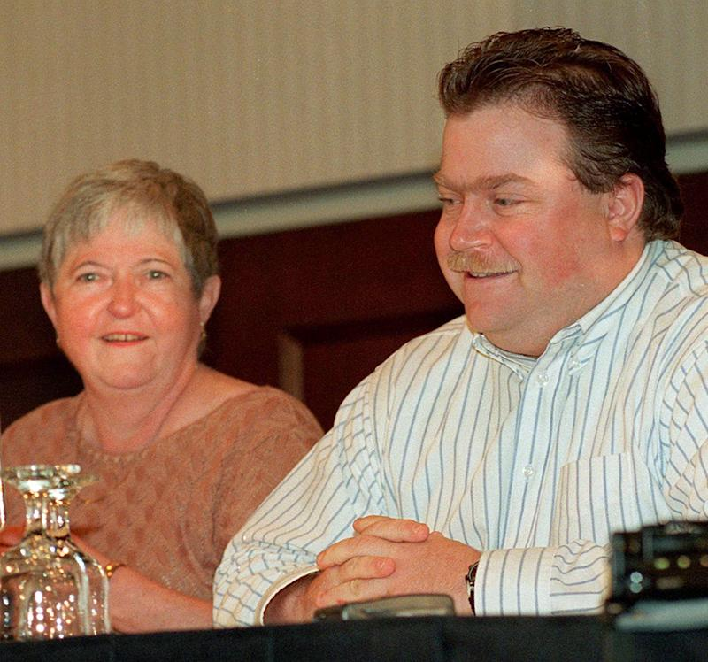 """Richard Jewell, cleared of suspicion in the Olympic Park bombing, and his mother Barbara, face the media as Jewell's attorney Lin Wood addressed the press conference in Marietta, Ga., Monday, Oct. 28, 1996. Jewell said the FBI and the media engaged in a """"mad rush"""" that nearly destroyed his life. (AP Photo/Ric Feld)"""