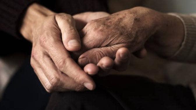 ilustrasi genggam tangan. (iStockphoto)
