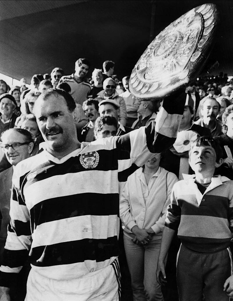Haden, the Auckland captain, holds up the Ranfurly Shield after victory against Canterbury in Christchurch in 1985 - Paul Estcourt/New Zealand Herald via AP