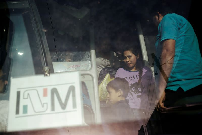FILE PHOTO: Central American migrants, returned from the U.S. to Nuevo Laredo in Mexico under the Migrant Protection Protocol to wait for their court hearing for asylum seekers, are seen arriving to Monterrey