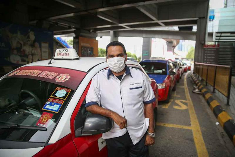 Taxi driver A. Mossess, 49, poses for a picture during an interview with Malay Mail in Kuala Lumpur March 27, 2020.