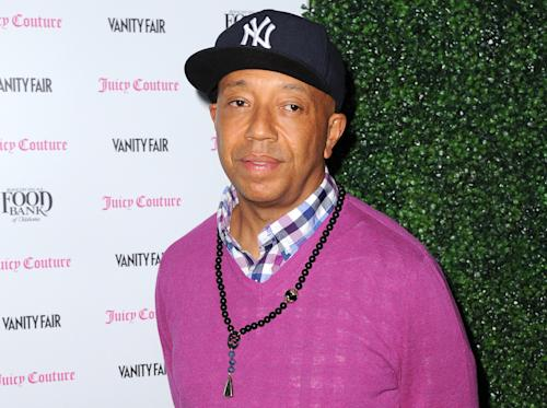 FILE - In this Feb. 18, 2013 file photo, Russell Simmons arrives at the Vanity Fair and Juicy Couture Celebration for the 2013 Vanities Calendar in Los Angeles. Simmons is apologizing for a parody video of Harriet Tubman in a sex tape that appeared on his All Def Digital YouTube channel. (Photo by Jordan Strauss/Invision/AP, File)