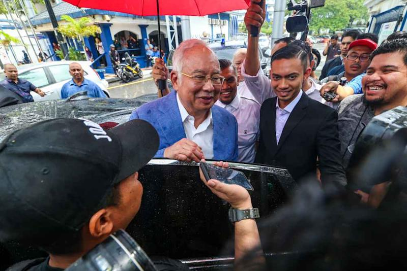 Former prime minister Datuk Seri Najib Razak speaks to reporters after giving his statement to the police at Bukit Aman October 18, 2019. ― Picture by Firdaus Latif