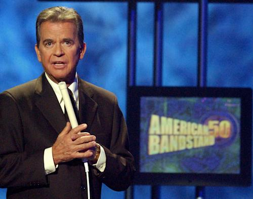 FILE - In this April 20, 2002 file photo, Dick Clark, host of the American Bandstand television show, introduces entertainer Michael Jackson on stage during taping of the show's 50th anniversary special in Pasadena, Calif. Syracuse University is naming a renovated broadcast studio on its campus for the late television producer and host, Dick Clark. The university announced Wednesday that Clark's name will grace one of the three buildings of the S.I. Newhouse School of Public Communications. Clark is a Syracuse alumnus and his family donated to the $18 million renovation project, which is scheduled to be done in September 2014. (AP Photo/Kevork Djansezian, File)