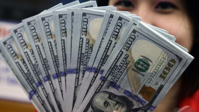 Nilai tukar rupiah terhadap dolar Amerika Serikat (AS) terus menguat, Jakarta, Kamis (23/10/2014) (Liputan6.com/Johan Tallo)
