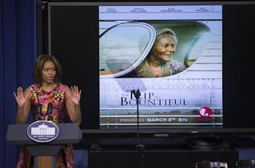 """First lady Michelle Obama gestures during remarks after a screening of the movie """"The Trip to Bountiful"""" in the South Court Auditorium on the White House complex on Monday, Feb. 24, 2014, in Washington. (AP Photo/ Evan Vucci)"""