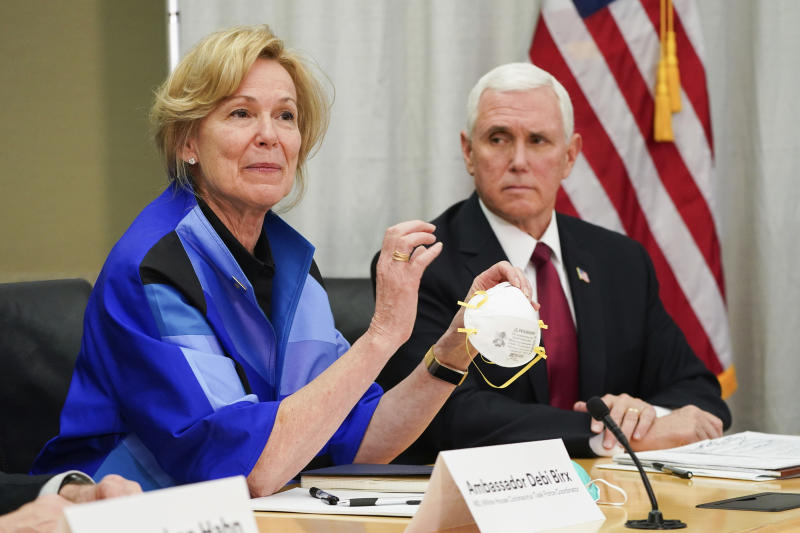 FILE - In this March 5, 2020, file photo, Dr. Deborah Birx, Ambassador and White House coronavirus response coordinator, holds a 3M N95 mask as Vice President Mike Pence visits 3M headquarters in Maplewood, Minn., in a meeting with 3M leaders and Minnesota Gov. Tim Walz to coordinate response to the COVID-19 virus. (Glen Stubbe/Star Tribune via AP, File)