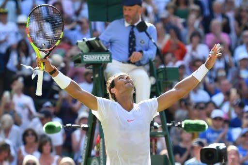 Victory salute: Rafael Nadal celebrates after beating Israel's Dudi Sela 6-3, 6-3, 6-2