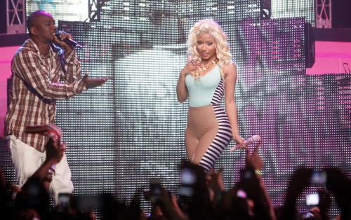 Nicki Minaj, Trinidadian-born American rapper, singer, songwriter and voice actress, performs with rapper Cam'ron at Roseland Ballroom on Tuesday, Aug. 14, 2012 in New York. (Photo by Jason DeCrow/Invision/AP)