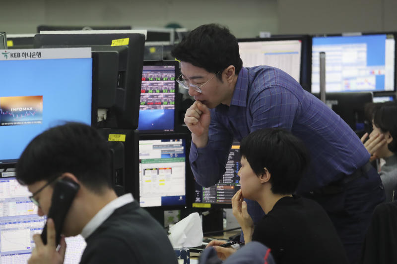 Currency traders watch monitors at the foreign exchange dealing room of the KEB Hana Bank headquarters in Seoul, South Korea, Friday, Jan. 3, 2020. Asian stocks were mixed Friday and oil prices surged after an Iranian general was killed by U.S. forces in Iraq. (AP Photo/Ahn Young-joon)