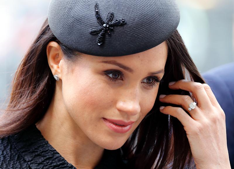 Meghan Markle holding her engagement ring up