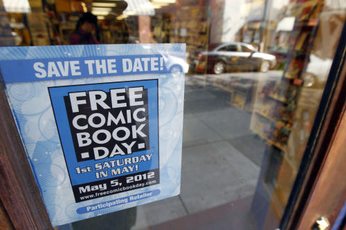 Shown is an advertisement for Free Comic Book Day at Fat Jack's Comicrypt, Friday, May 4, 2012, in Philadelphia. Like hundreds of other comic specialty shops in 46 countries, the store is participating in Free Comic Book day on Saturday, May 5, which sees shops give away free copies of new and reprinted comics from some 40 publishers, including Marvel, DC, Archie, Image, Dark Horse, Valiant and Dynamite, among others, to promote the growth of the medium and garner new readers, some of whom may have been exposed to heroes through television and films. Free Comic Book day started 11 years and continues to expand, said Joe Field, who helped organize the inaugural event. This year, some 3.5 million free comics will be handed out. (AP Photo/Matt Rourke)