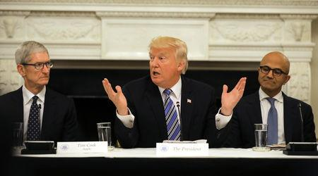 FILE PHOTO - U.S. President Donald Trump participates in an American Technology Council roundtable, accompanied by Tim Cook, CEO of Apple (L) and Satya Nadella CEO of Microsoft Corporation at the White House in Washington, U.S., June 19, 2017. REUTERS/Carlos Barria