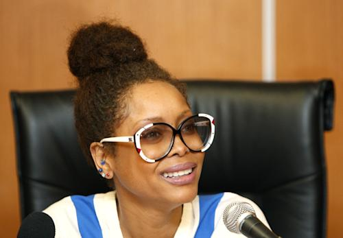 U.S. singer Erykah Badu speaks during a press conference in Kuala Lumpur, Malaysia, Wednesday, Feb. 29, 2012. Muslim-majority Malaysia on Tuesday banned a planned concert by Badu after a photograph appeared showing the Grammy-winning singer with the Arabic word for Allah written on her body. (AP Photo/Lai Seng Sin)