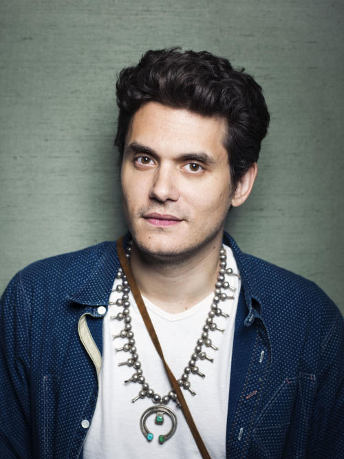"This Aug. 12, 2013 file photo shows singer-songwriter John Mayer poses in New York. Mayer is releasing his sixth album, ""Paradise Valley,"" on Tuesday, Aug. 20. It features collaborations with his singer-girlfriend Katy Perry and R&B singer Frank Ocean. (Photo by Victoria Will/Invision/AP)"