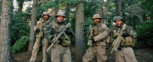 "This photo released by Universal Pictures shows, from left, Taylor Kitsch, as Michael Murphy, Mark Wahlberg as Marcus Luttrell, Ben Foster as Matt ""Axe"" Axelson, and Emile Hirsch as Danny Dietz in a scene from the film, ""Lone Survivor."" ""Frozen's"" grip on the domestic box office is heading for a meltdown as the combat docudrama ""Lone Survivor"" threatens a firefight for the top spot with an expected gross of $15 million. (AP Photo/Universal Pictures)"