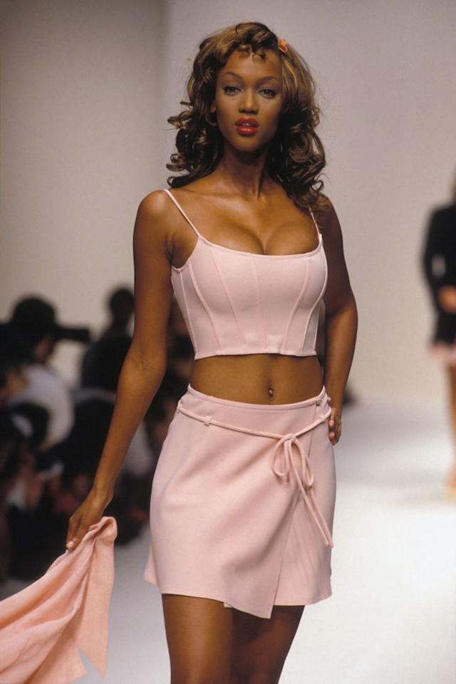 """<p>Back in the 90s, Tyra Banks wasn't yet a reality television host, but a very popular supermodel breaking all sorts of barriers. Banks started modeling in fashion shows at 15 years old, and quickly became one of the top models in the country. She was the first African-American woman to cover both <em>GQ</em> and the <em>Sports Illustrated Swimsuit Issue</em>. In 1997, she received VH1's """"Supermodel of the Year"""" award, and she was a Victoria's Secret Angel for almost a decade. She also dabbled in acting with roles in <em>The Fresh Prince of Bel-Air</em> and <em>Coyote Ugly</em>.  </p>"""