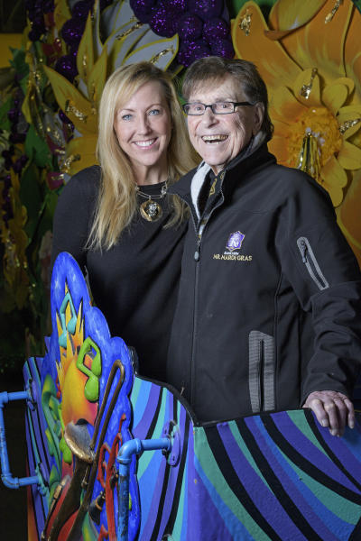 "FILE - In this Jan. 31, 2018 file photo, Blane Kern, poses with his wife Holly, on a float in his float den at Mardi Gras World in New Orleans. The man known as ""Mr. Mardi Gras"" for helping to convert the annual pre-Lenten celebration into a giant event in New Orleans has died. News outlets report that Blaine Kern Sr. died Thursday, June 25, 2020. For decades, Kern's work helped boost New Orleans' Carnival.  (Max Becherer/The Advocate via AP)"