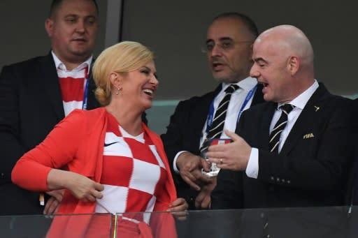 Croatia President Kolinda Grabar-Kitarovic showed FIFA president Gianni Infantino that she was wearing the team's colours in Sochi