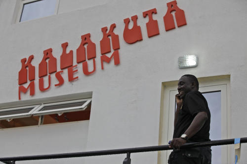 A man takes a call on the balcony of Kalakuta Museum in Lagos, Nigeria, on Monday, Oct. 15, 2012. The family of late Afrobeat singer Fela Anikulapo-Kuti celebrated the opening of the Kalakuta Museum on Monday in Lagos in the home the musician once lived in. The opening of the museum comes during Felabration, an annual music festival honoring the singer. (AP Photo / Sunday Alamba)