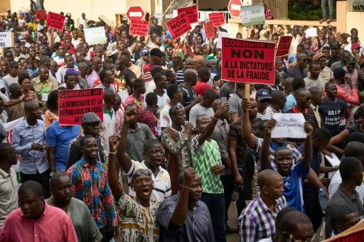 Demonstrators take part in a protest against incumbent Malian President Ibrahim Boubacar Keita in Bamako on August 11, the eve of the second round of presidential elections