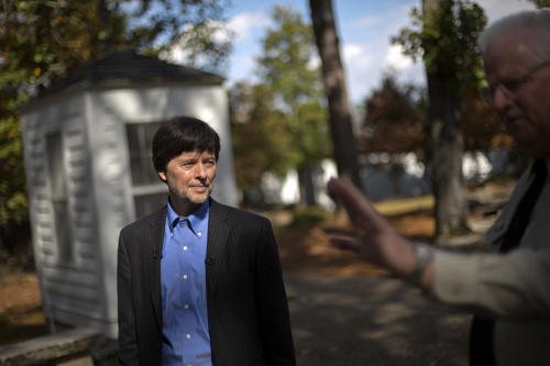 Documentary filmmaker Ken Burns walks through the entrance of the Georgia home used by former President Franklin D. Roosevelt during a tour by site manager Robin Glass, right, Saturday, Nov. 2, 2013, in Warm Springs, Ga. Burns along with several members of the Roosevelt family toured the home known as the Little White House Saturday used by Roosevelt as Burns previewed parts of his 14-hour film on the Roosevelt's. (AP Photo/David Goldman)