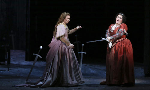 This photo provided by the Houston Grand Opera shows Natalya Romaniw, left, performing the role of Ines and Tamara Wilson as Leonora in Il Trovatore in Houston. (AP Photo/Houston Grand Opera, Felix Sanchez