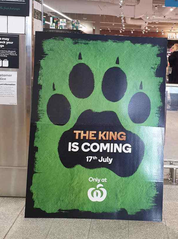 Photo of a promotional poster inside a Woolworths Lion King store in Adelaide, South Australia.
