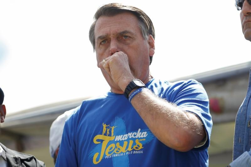 Brazil's President Jair Bolsonaro reacts during an evangelical march for Jesus in Brasilia