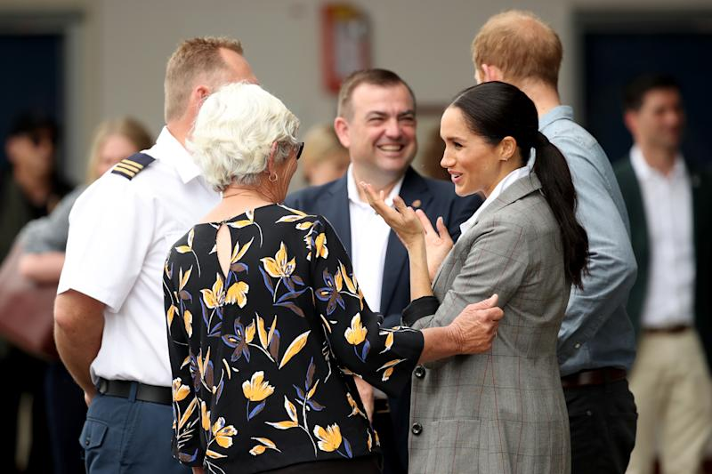 The royal couple meet with health workers as they visit the Royal Flying Doctors Service hangar. Photo: Getty, meghan markle prince harry dubbo, meghan markle prince harry australia, meghan markle serena williams jacket, meghan markle pregnant
