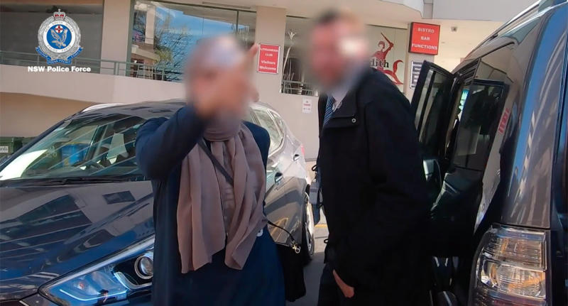 A woman, suspected of being part of a $4 million family day care fraud syndicate in Sydney, is caught on video shouting, pointing, and swearing at a police officer. Source: NSW Police
