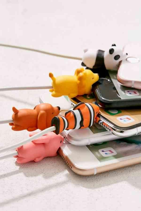 """<p>Charging their phones just got a hell of a lot cuter thanks to these <product href=""""https://www.urbanoutfitters.com/shop/cable-bite?category=stationery-desk-supplies&amp;color=089"""" target=""""_blank"""" class=""""ga-track"""" data-ga-category=""""internal click"""" data-ga-label=""""https://www.urbanoutfitters.com/shop/cable-bite?category=stationery-desk-supplies&amp;color=089"""" data-ga-action=""""body text link"""">Cable Bites</product> ($6 each).</p>"""