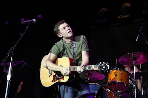 "FILE - In this Sept. 15, 2012 file photo, Scotty McCreery performs at Aarons Amphitheater in Atlanta. McCreery rode a wave of success after winning the 2011 season of ""American Idol,"" with his first record going platinum and winning several new artist awards. But with his sophomore album, ""See You Tonight,"" McCreery says his career is now in his hands alone. (Photo by Robb Cohen/RobbsPhotos/Invision/AP, File)"