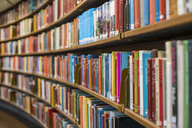 A stock photo of a library shelf.