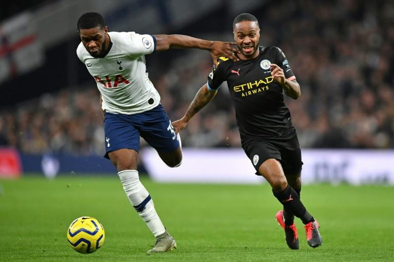Manchester City's Raheem Sterling (right) has expressed concern over a quick return for the Premier League