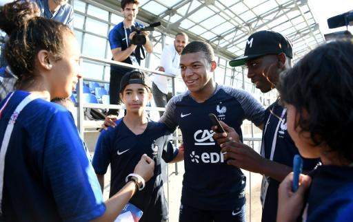 Young fans from Bondy took pictures with France star Kylian Mbappe after a training session in Russia