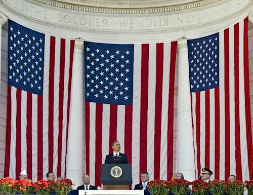 President Barack Obama speaks during a Veterans Day ceremony at the Arlington National Cemetery Amphitheater in Arlington, Va., Sunday, Nov. 11, 2012. (AP Photo/J. Scott Applewhite)
