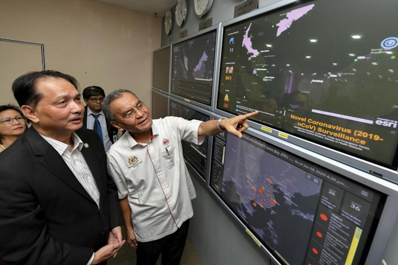 Health Minister Datuk Seri Dzulkefly Ahmad monitors the status of the virus' spread in Malaysia and around the world on the Disaster, Outbreak, Crisis and Emergency Management System after a press conference on the novel coronavirus at the National Crisis Preparedness and Response Centre in Putrajaya January 25, 2020. With him is Health D-G Datuk Dr Noor Hisham Abdullah. — Bernama pic