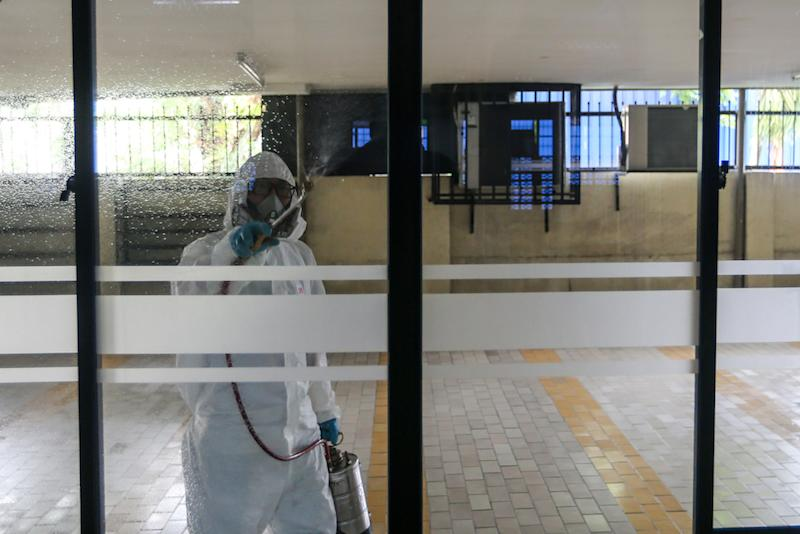 A worker sprays disinfectant in a mosque to prevent the spread of the novel coronavirus in Kuala Lumpur March 23, 2020. — Picture by Firdaus Latif